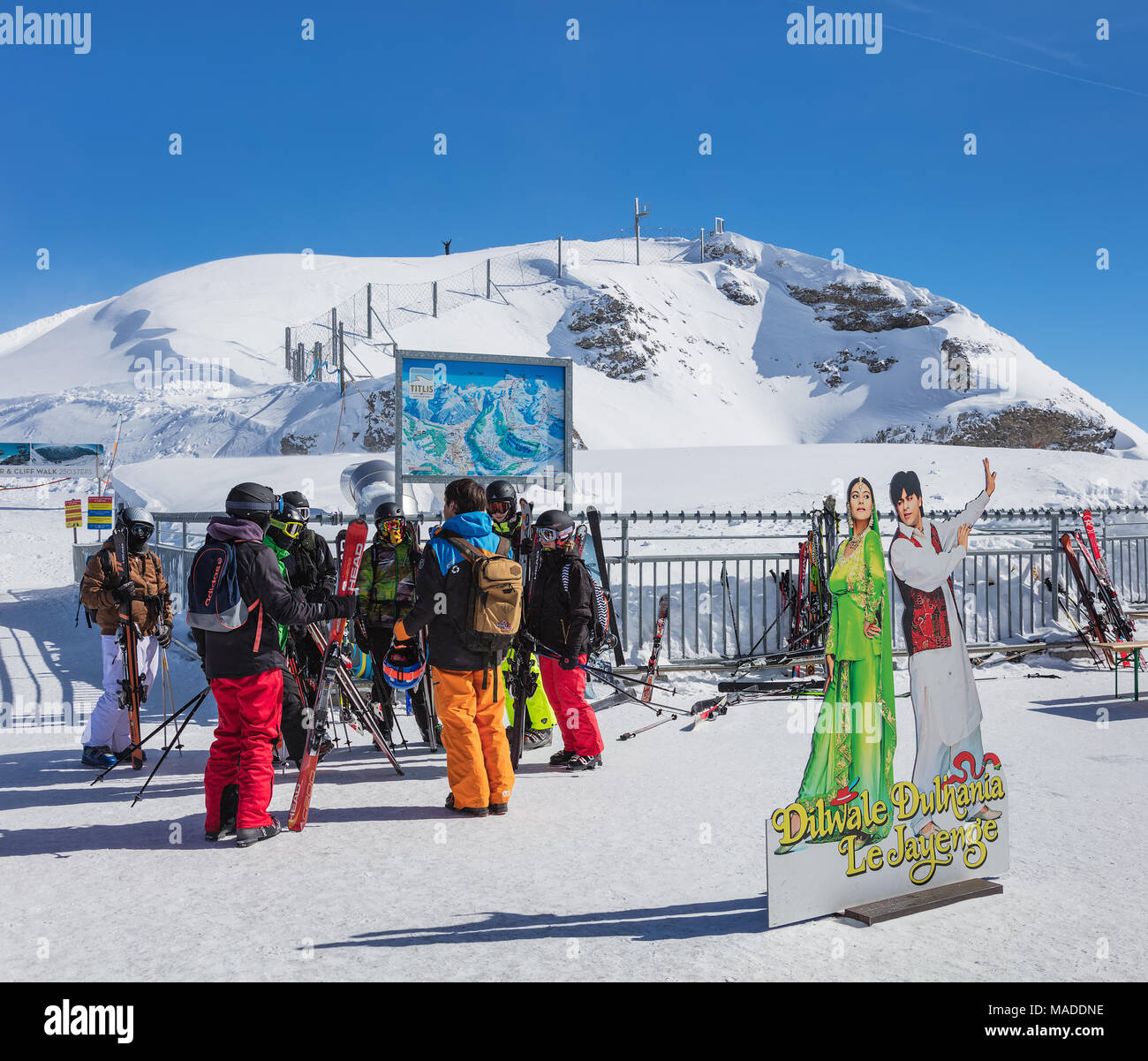 Engelberg, Switzerland - 9 March, 2016: a group of skiers on the top of the Mt. Titlis. The Titlis is a mountain located on the border between the Swi - Stock Image