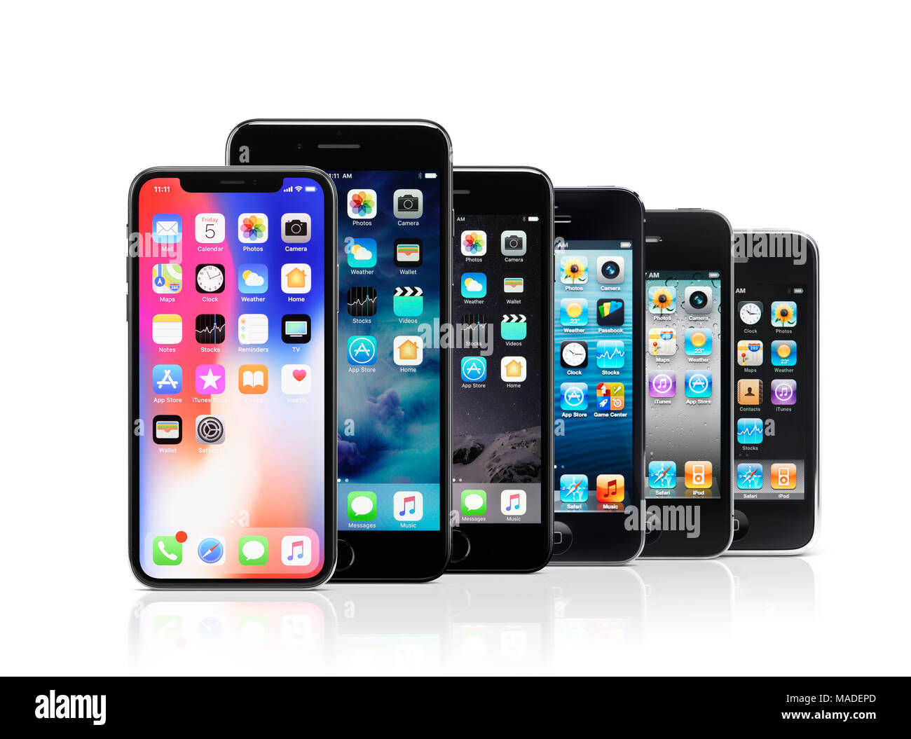 Apple iPhone line-up, iPhone X, 7 plus, 7, 5s, 4, 3, from newer to older models of previous smartphone generations, isolated on white studio backgroun Stock Photo