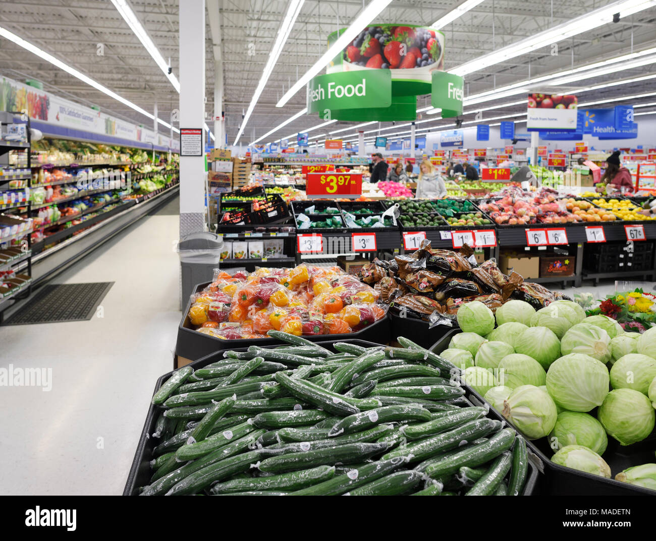 Vegetables at Walmart store fresh food section. Cucumbers, cabbage, sweet peppers. British Columbia, Canada 2017. Stock Photo