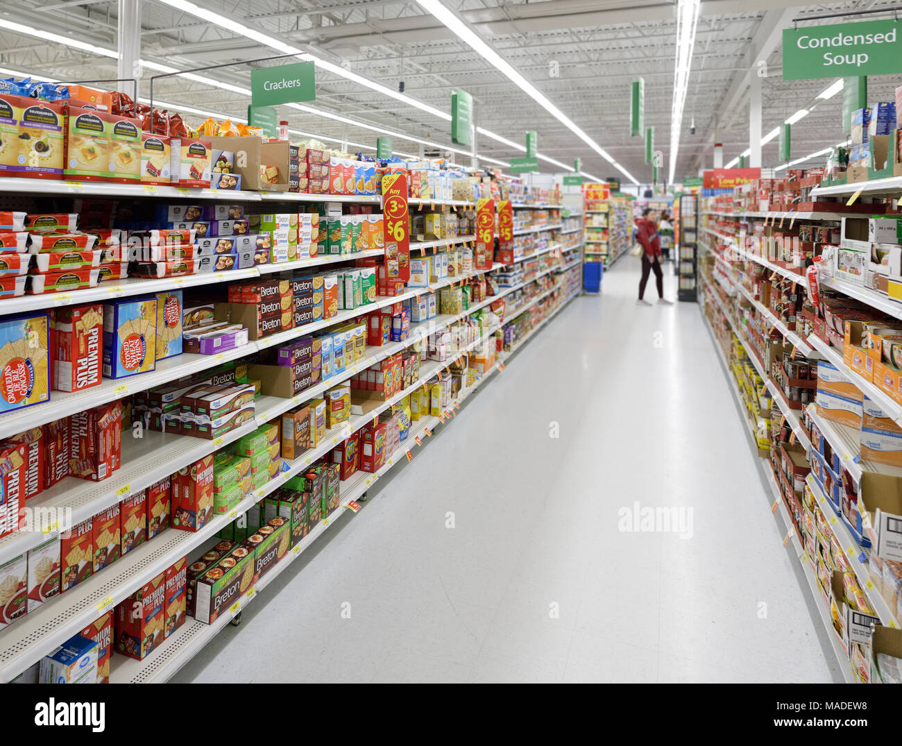 Groceries and canned food aisles at Walmart store food section. British Columbia, Canada 2017. Stock Photo