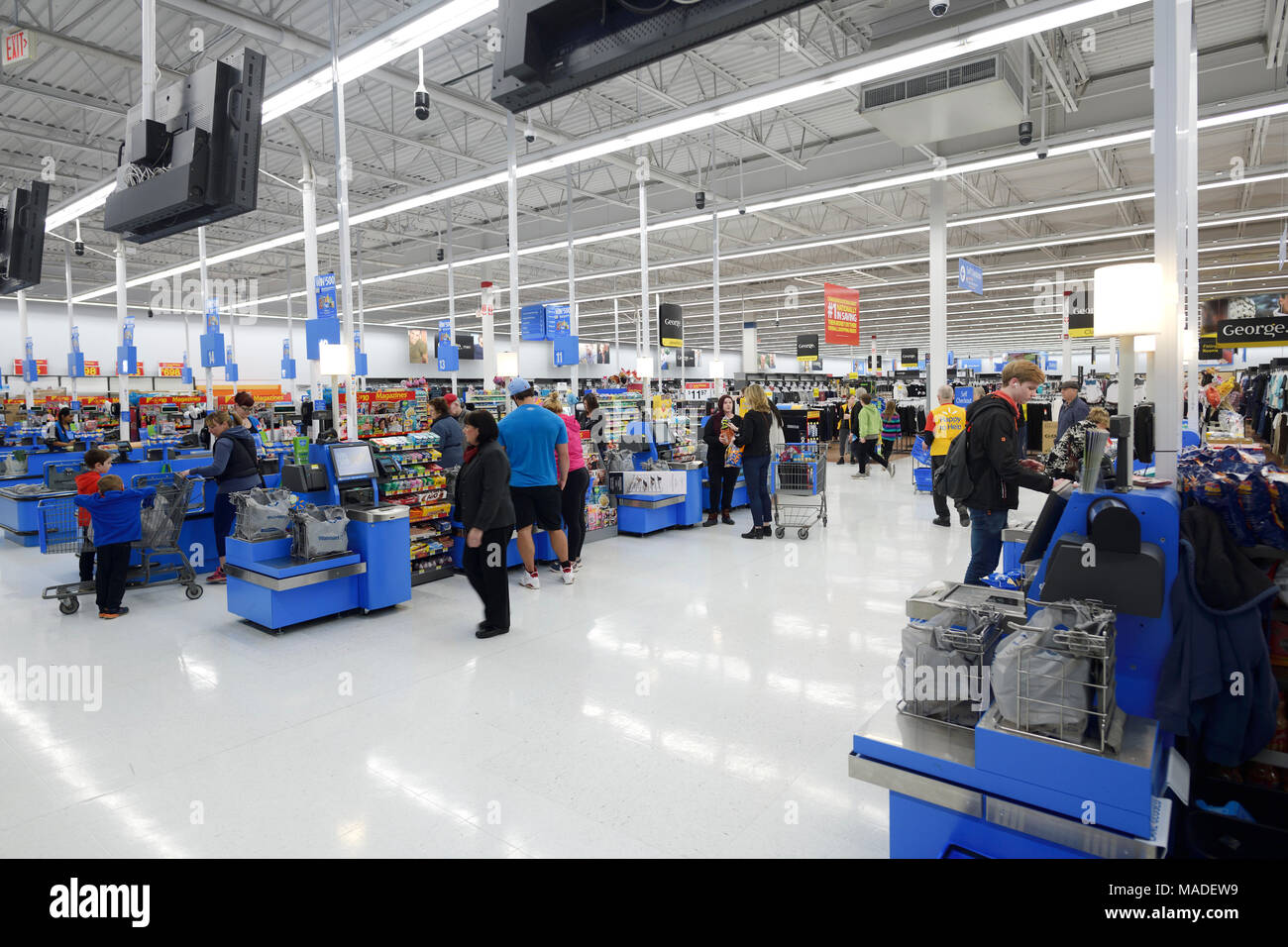 Self-checkout counters, self-service checkout section at Walmart store. British Columbia, Canada 2017. Stock Photo