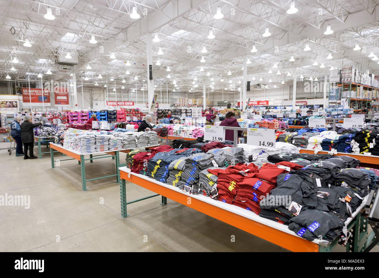 Costco Wholesale membership warehouse store interior, T-shirts at the mens clothing section. British Columbia, Canada 2017. - Stock Image