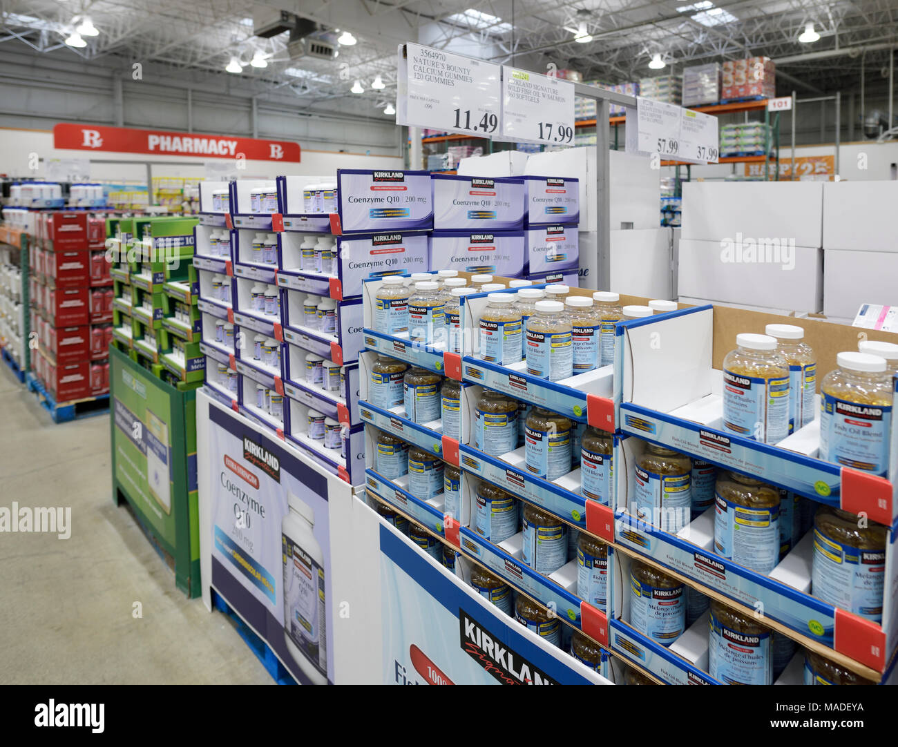 Vitamins and Kirkland brand food supplements at Costco Wholesale membership warehouse store pharmacy section. Fish oil and Coenzyme Q10 British Columb - Stock Image