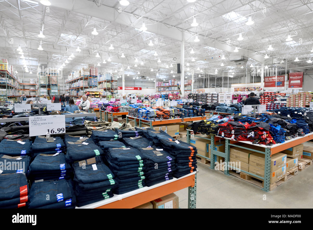 Costco Wholesale membership warehouse store interior, jeans at the mens clothing section. British Columbia, Canada 2017. Stock Photo