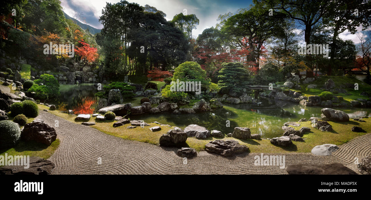 Panoramic scenery of a traditional Japanese Zen rock garden with a pond and bridges leading to islands Kameshima and Tsurushima with white pine trees. Stock Photo