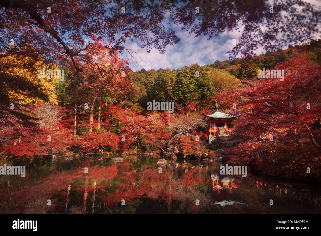 Beautiful reflective pond in front of Bentendo Hall in a colorful autumn scenery at Daigo-ji temple, Shimo-Daigo part of Daigoji complex in Fushimi-ku - Stock Image