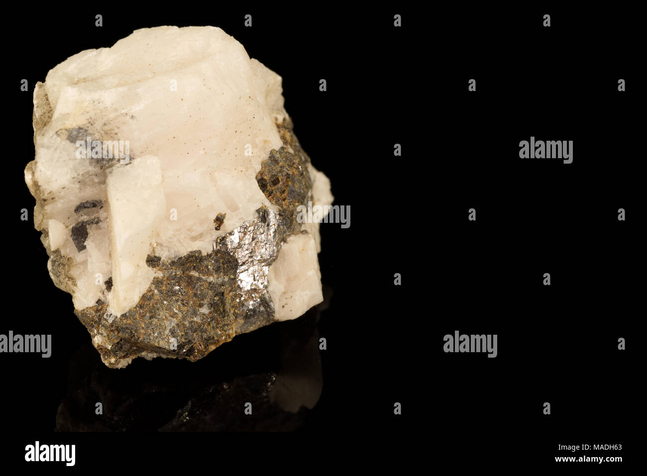 Sphalerite zinc mineral ore isolated on black background. Zinc sulfide in crystalline form. Rocks and minerals - Stock Image