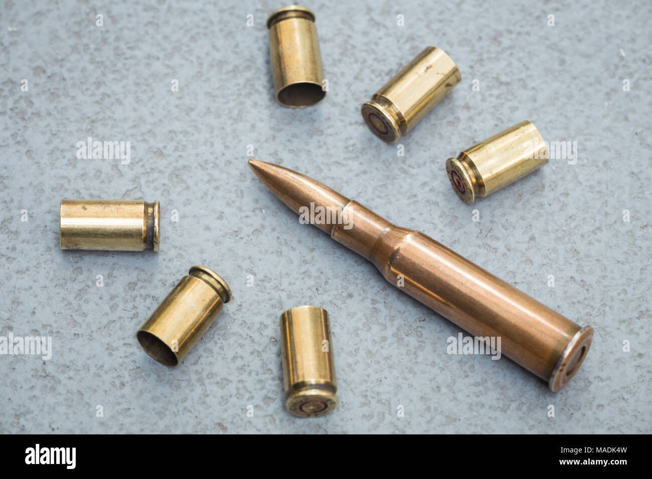 cartridges and scales from various types of weapons - Stock Image