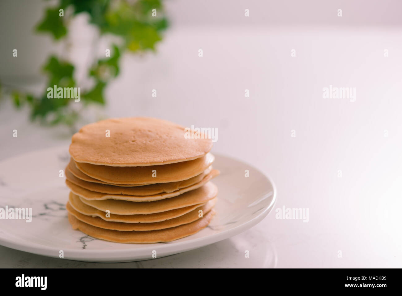 Cooking for breakfast. Delicious homemade pancakes on a plate - Stock Image