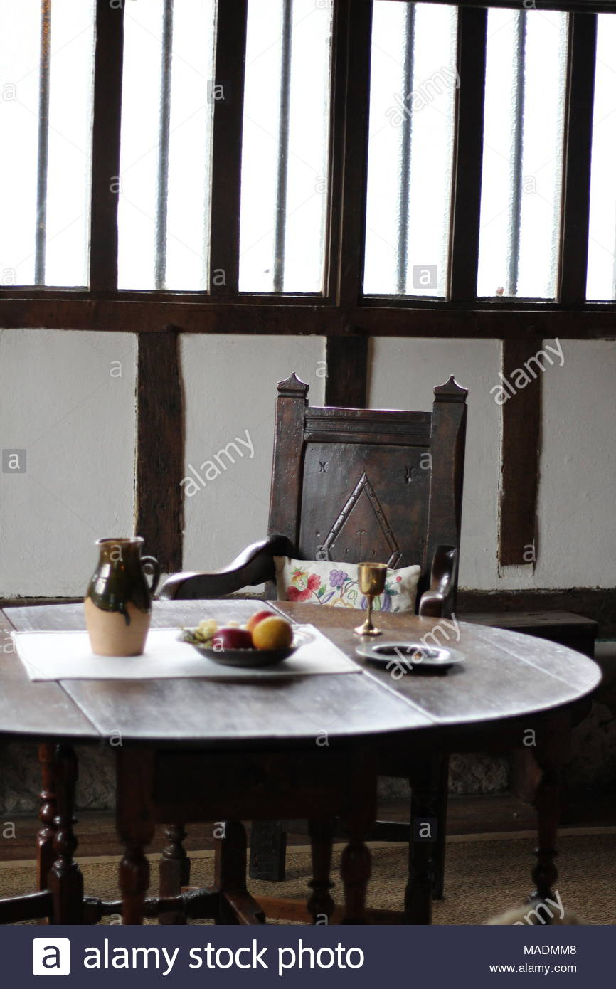 Staging the medieval scene - still taken of dining area in the great hall of Southchurch Hall,14th Cent Medieval moated house, Southend on Sea, Essex. - Stock Image