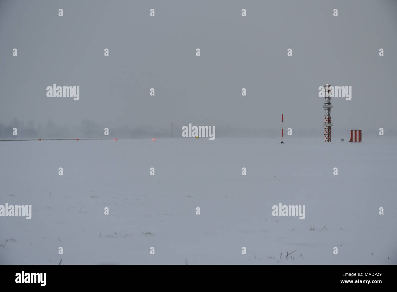London Southend Airport infrastructure in snow bad weather during the Beast from the East weather phenomenon. ILS Glide slope tower landing system - Stock Image
