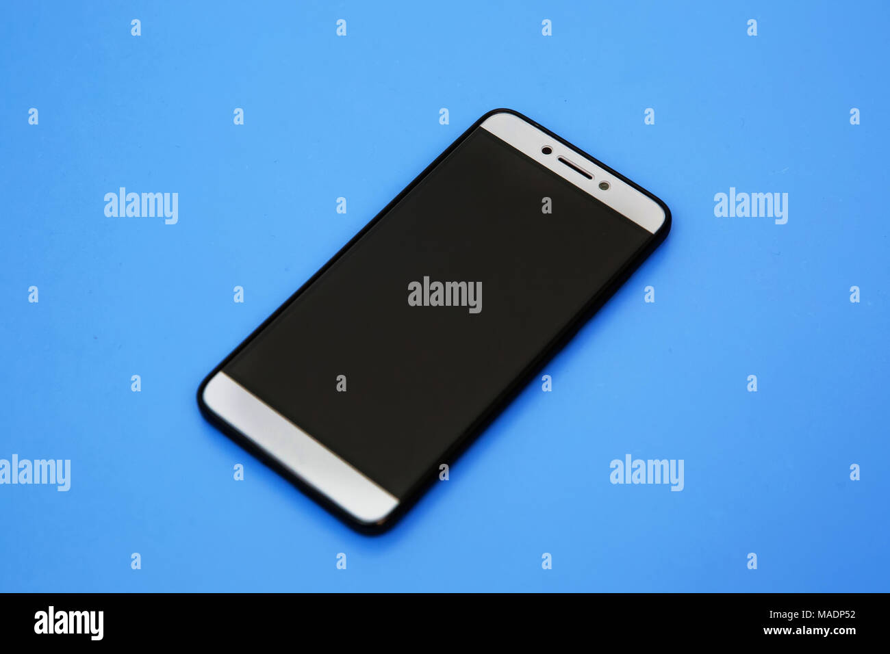 Black smartphone mockups. Can use for printing, website, presentation element. for app demo on phone. Empty screen . Black smartphone in blue backgrou Stock Photo