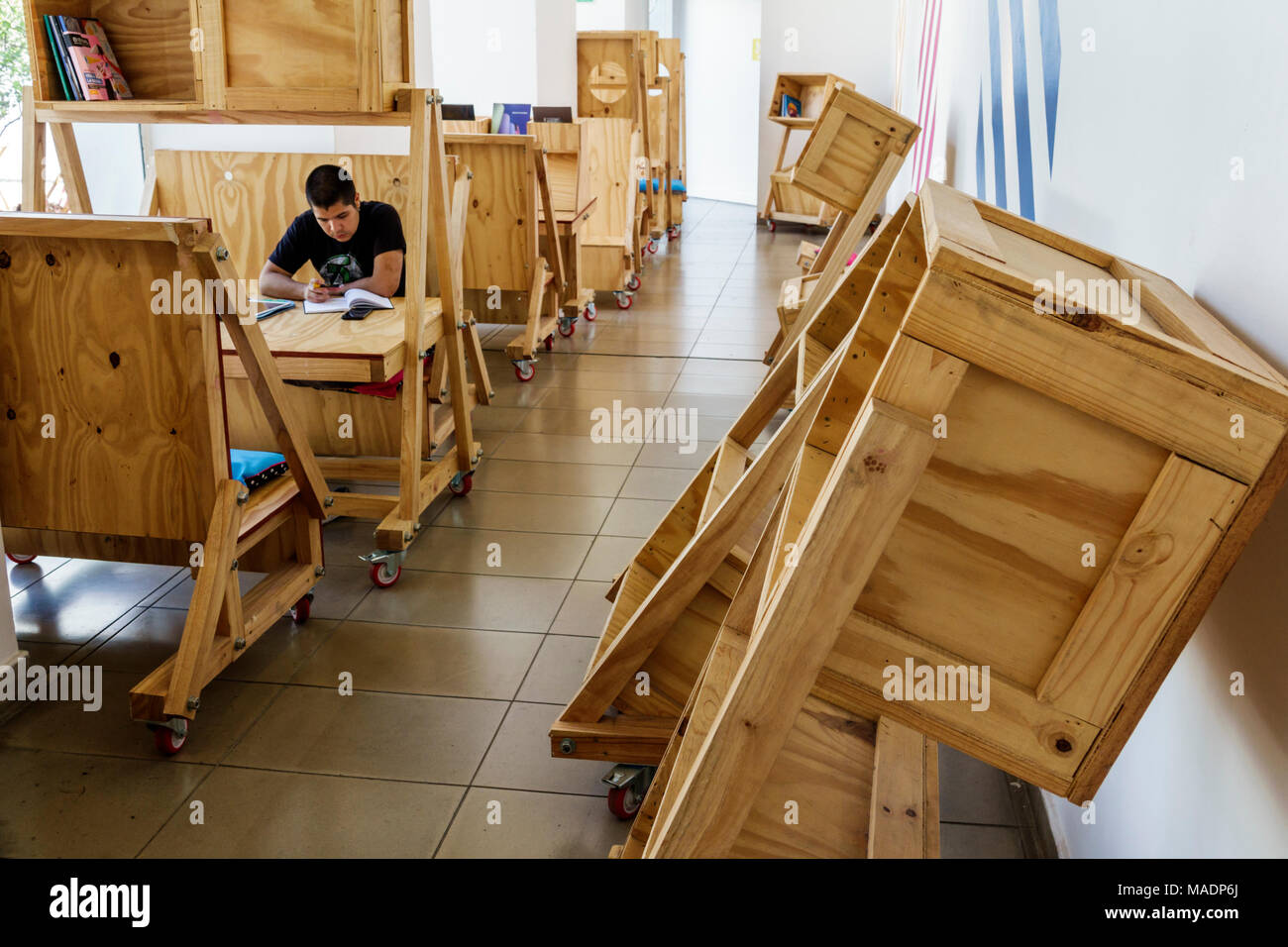 Buenos Aires Argentina Centro Cultural Recoleta Center Art Gallery Interior  Library Crate Furniture Rustic Desk Boy Teen Reading Hispanic Argentinean  ...