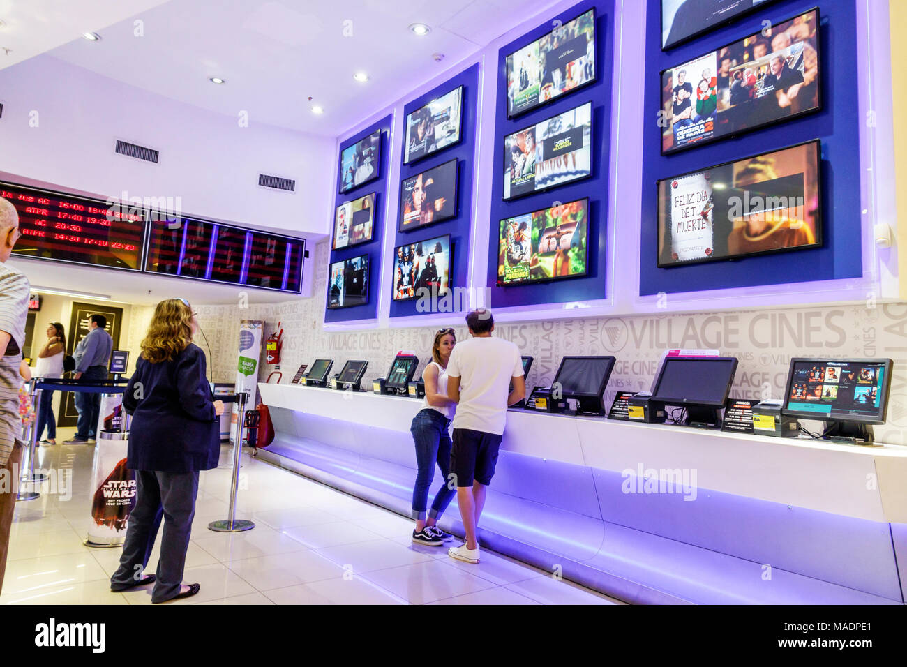 Buenos Aires Argentina Recoleta Mall shopping interior Village Cines multiplex movie theater theatre cinema feature films self-serve ticket machines man woman Hispanic Argentinean Argentinian Argentine South America American - Stock Image