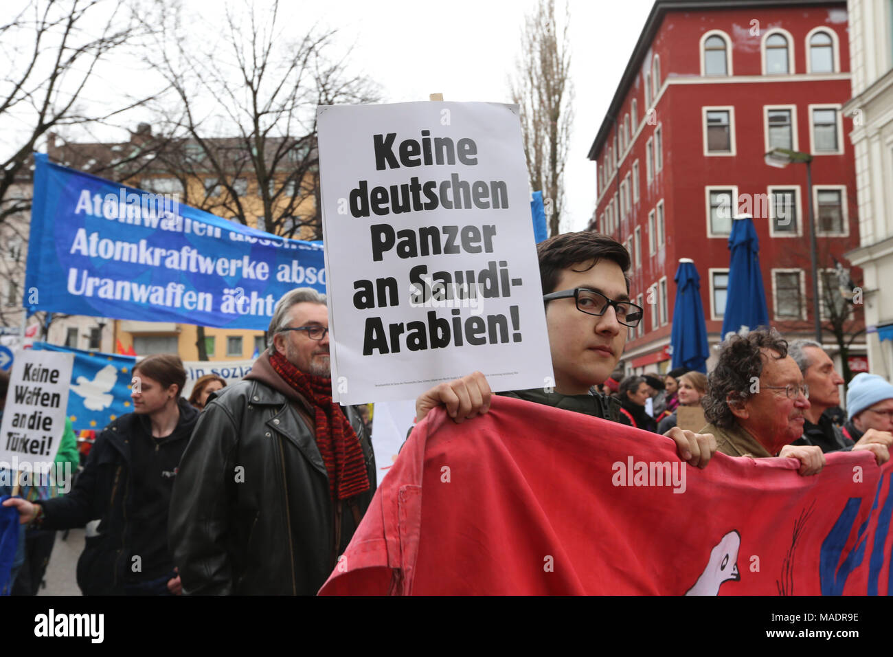Munich, Germany. 31st Mar, 2018. Protestor has a sign speaking against arms export. Some thousand joined the Ostermarsch (easter march) for peace and disarmament. The Ostermarsch is a traditional peace demonstration, which is held yearly in hundreds of German towns. Credit: Alexander Pohl/Pacific Press/Alamy Live News Credit: PACIFIC PRESS/Alamy Live News - Stock Image