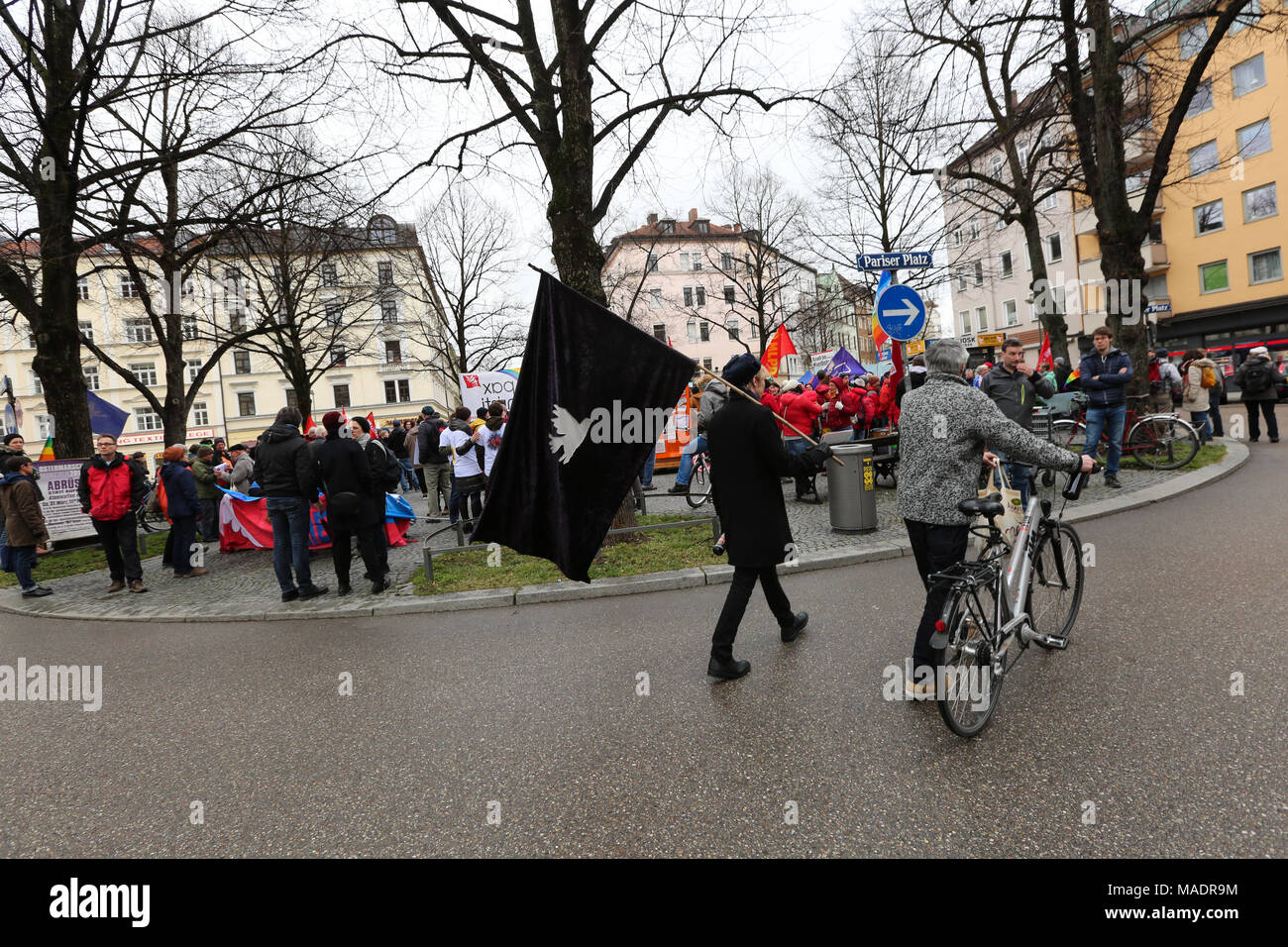 Munich, Germany. 31st Mar, 2018. A man wearing black clothes with a black flag with a white pigeon. Some thousand joined the Ostermarsch (easter march) for peace and disarmament. The Ostermarsch is a traditional peace demonstration, which is held yearly in hundreds of German towns. Credit: Alexander Pohl/Pacific Press/Alamy Live News Credit: PACIFIC PRESS/Alamy Live News - Stock Image