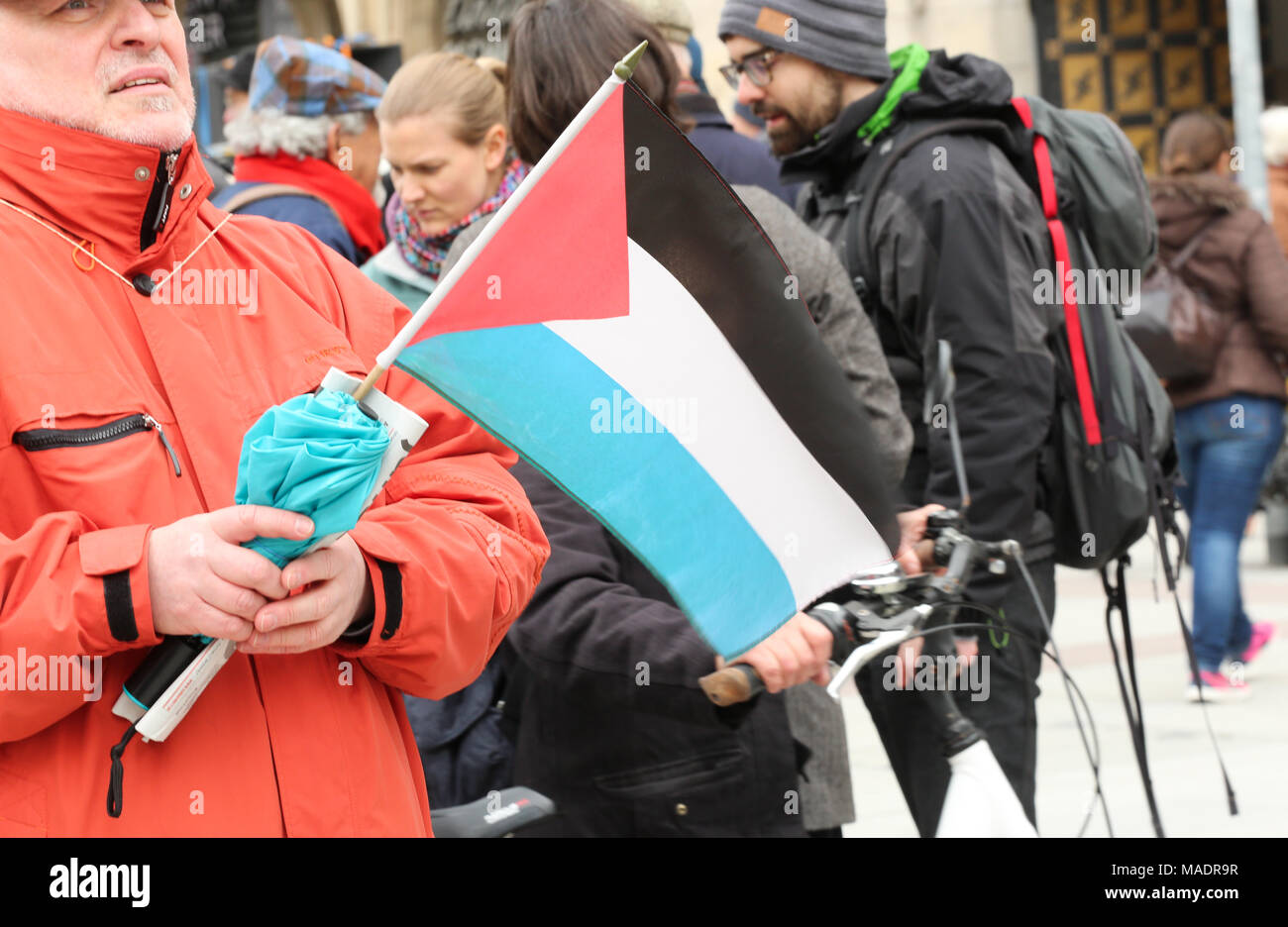 Munich, Germany. 31st Mar, 2018. A man with a Palestinian flag. Some thousand joined the Ostermarsch (easter march) for peace and disarmament. The Ostermarsch is a traditional peace demonstration, which is held yearly in hundreds of German towns. Credit: Alexander Pohl/Pacific Press/Alamy Live News Credit: PACIFIC PRESS/Alamy Live News - Stock Image