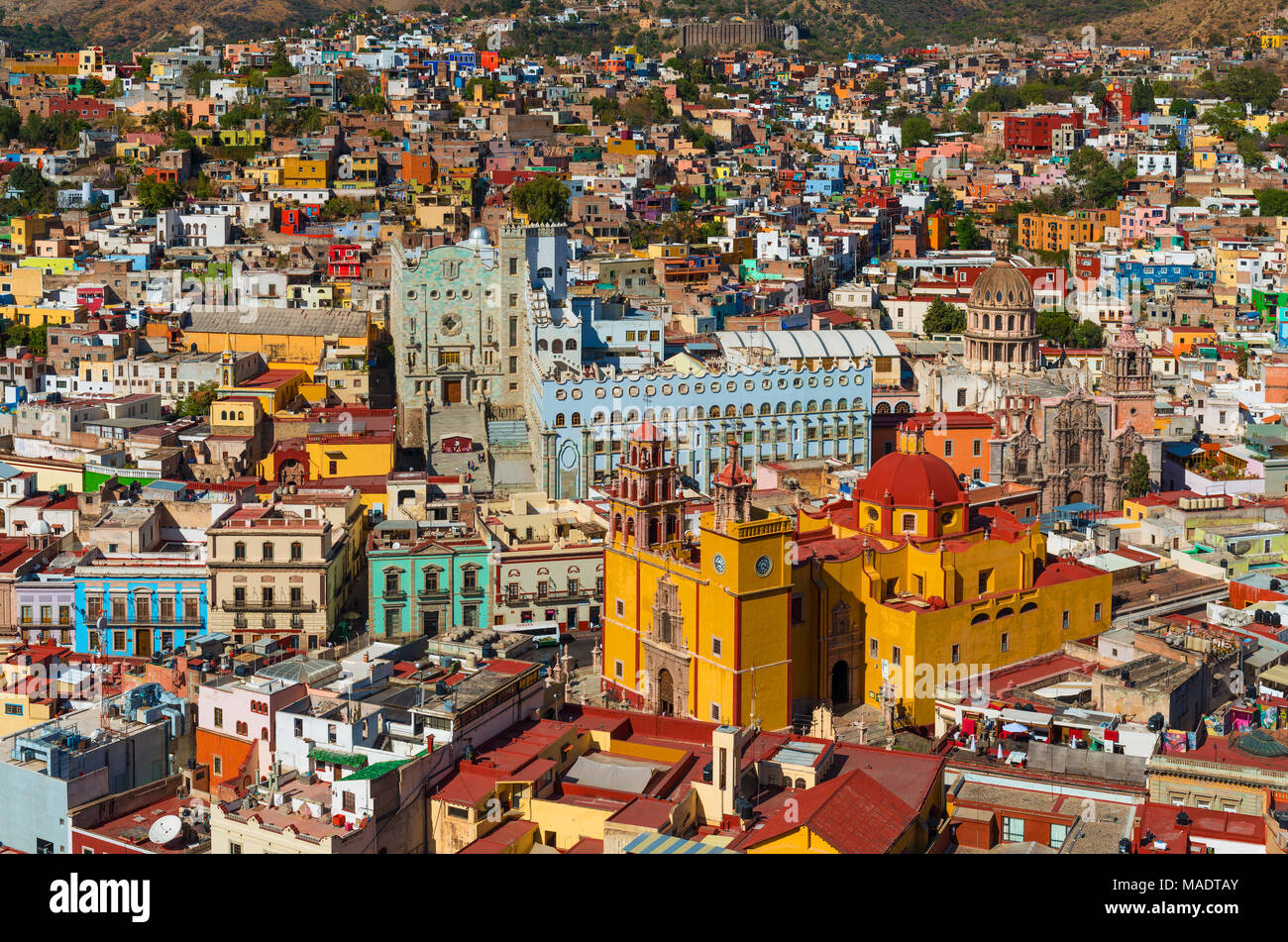 Close up and aerial view of Guanajuato city center with the Our Lady of Guanajuato Cathedral and its colourful architecture on a summer day, Mexico. - Stock Image
