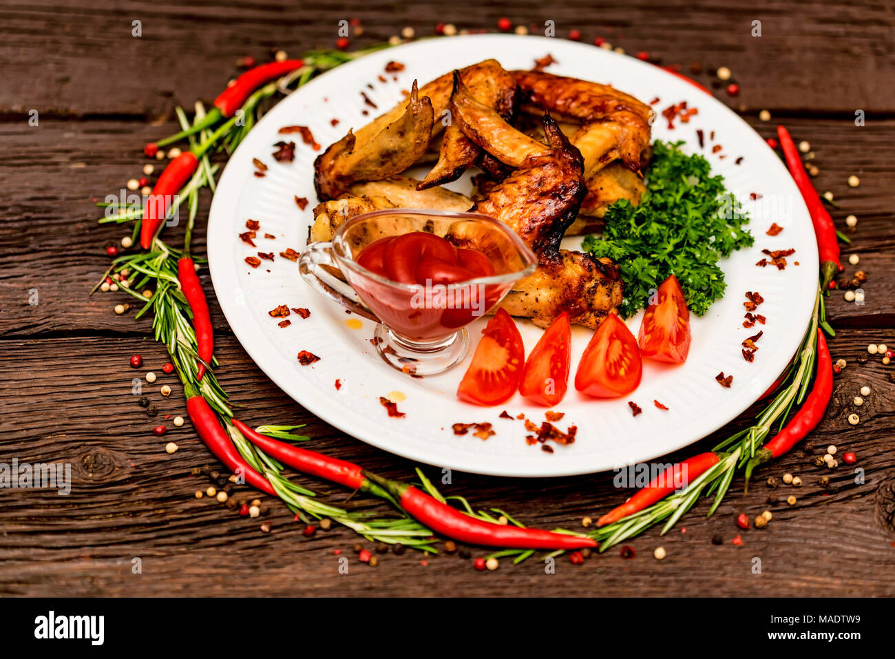 Chicken wings grilled with spices and chili pepper Stock Photo
