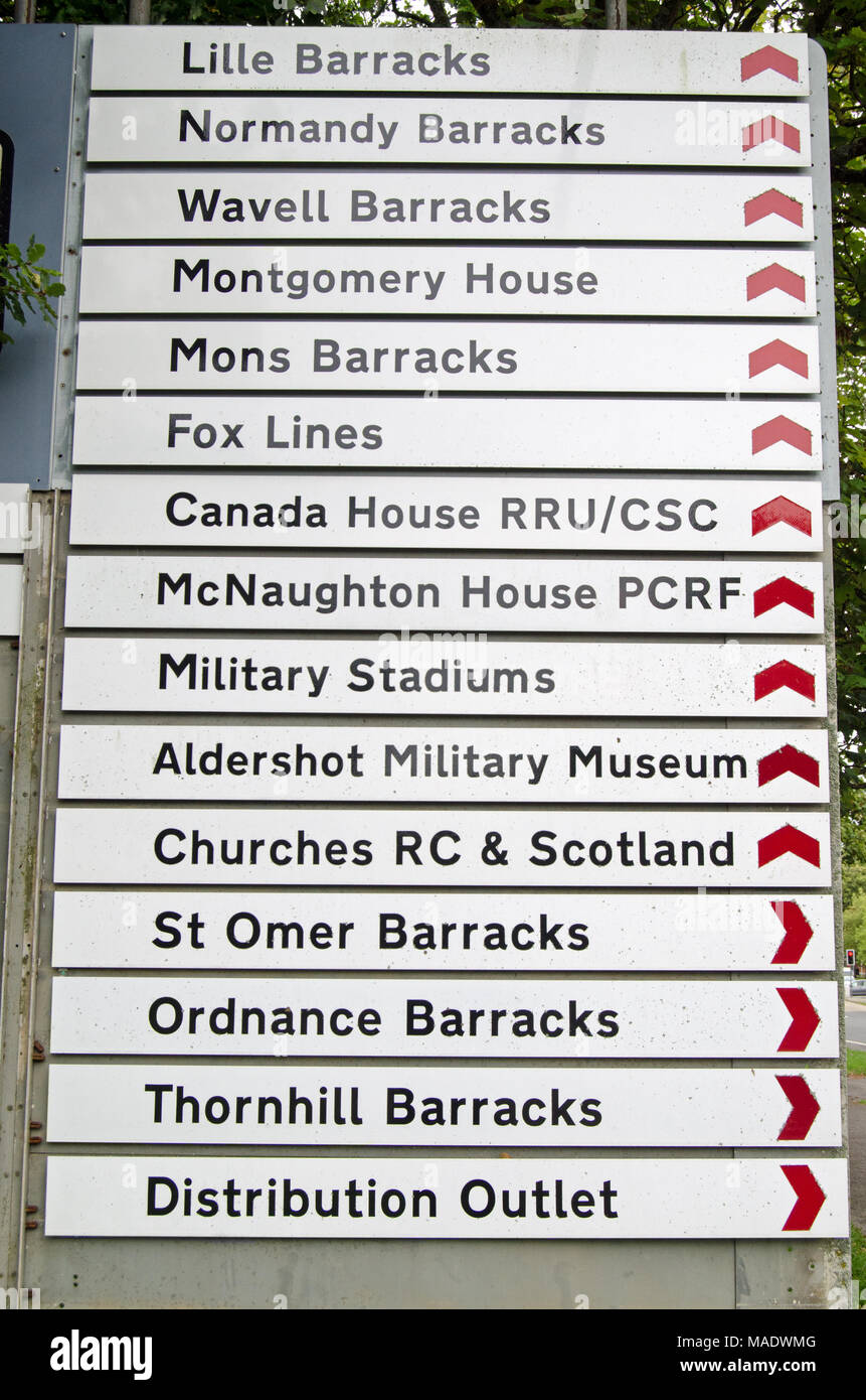 Signposts to various places in the military town of Aldershot, Hampshire.  The historic garrison town is home to many elements of the British Army. - Stock Image