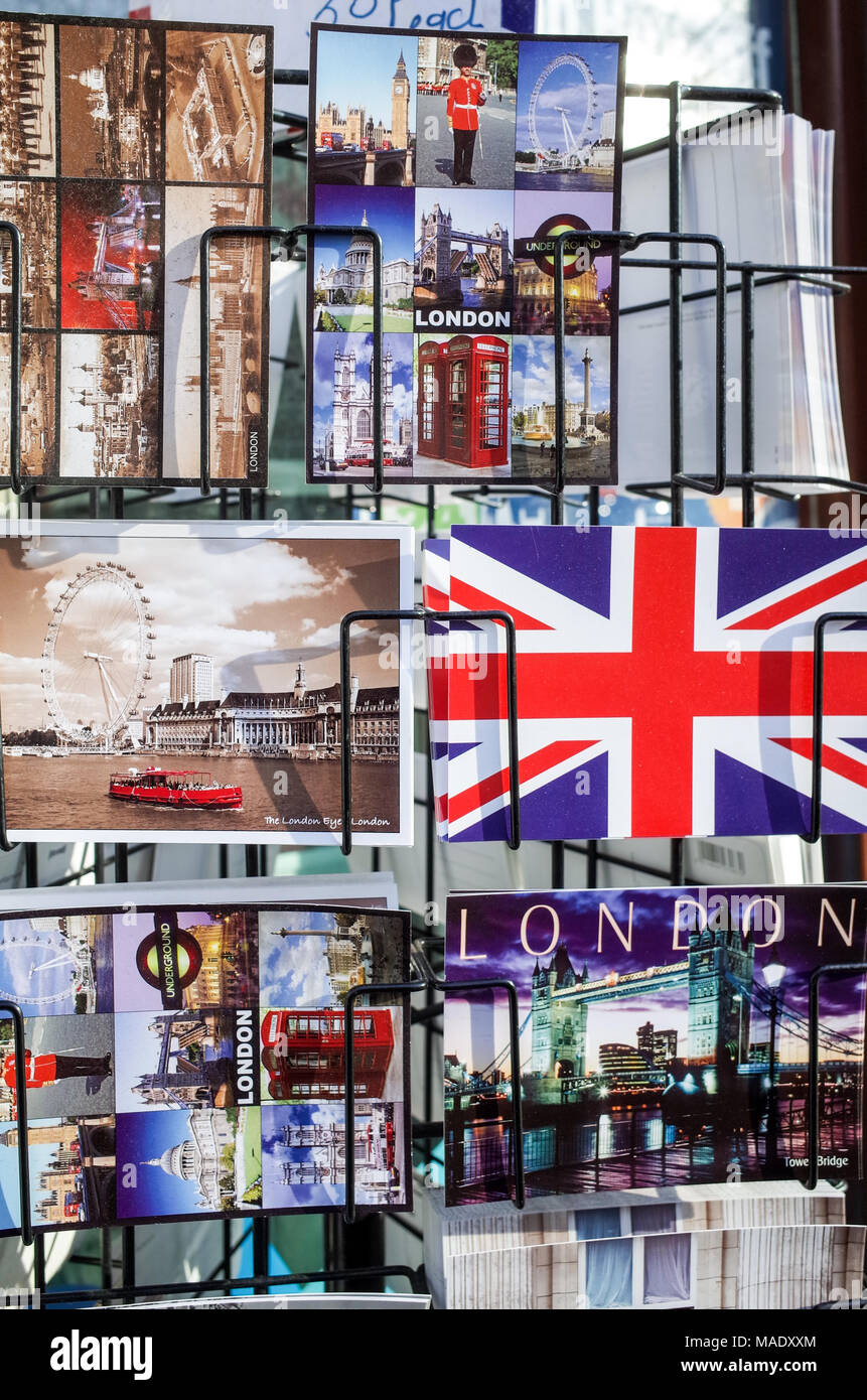 British Tourist postcards in a rack in London - Stock Image