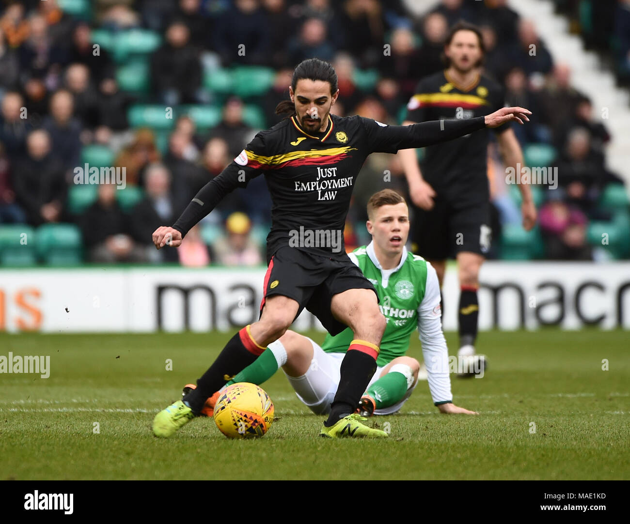 Scottish Premiereship, Hibernian v Partick Thistle, Edinburgh, Midlothian, UK. 31,03, 2018. Pic shows:  Partick Thistle midfielder Ryan Edwards escapes the attention of Hibs' Florian Kamberi during the  Scottish Premiereship clash between Hibernian and Partick Thistle at Easter Road Stadium, Edinburgh.  Credit: Alamy/Ian Jacobs - Stock Image