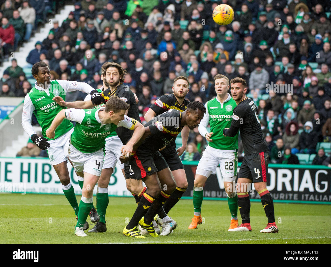 Scottish Premiereship, Hibernian v Partick Thistle, Edinburgh, Midlothian, UK. 31,03, 2018. Pic shows:  Hibs defender, Paul Hanlon, heads home to score his side's second goal during the second half of the Scottish Premiereship clash between Hibernian and Partick Thistle at Easter Road Stadium, Edinburgh.  Credit: Alamy/Ian Jacobs - Stock Image