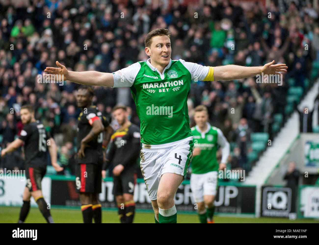 Scottish Premiereship, Hibernian v Partick Thistle, Edinburgh, Midlothian, UK. 31,03, 2018. Pic shows:  Hibs defender, Paul Hanlon, celebrates after scoring his side's second goal during the second half of the Scottish Premiereship clash between Hibernian and Partick Thistle at Easter Road Stadium, Edinburgh.   Credit: Alamy/Ian Jacobs - Stock Image