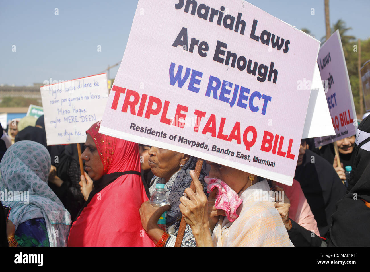 Mumbai, India. 31st Mar, 2018. Thousands of Muslim women attired in the black Burqa staged a Protest march at Azad Maidan, demanding withdrawal of the bill banning 'Triple Talaq' passed by Lok Sabha last December 2017.Organised by the All India Muslim Personal Law Board's (AIMPLB) Women Wing, and described as the ''first, exclusive Muslim women's protest rejecting the Bill and supporting the Sharia Laws'' it elicited huge response from Muslim women across the country. The women carried placards loudly proclaiming their demands with slogans opposing the M - Stock Image
