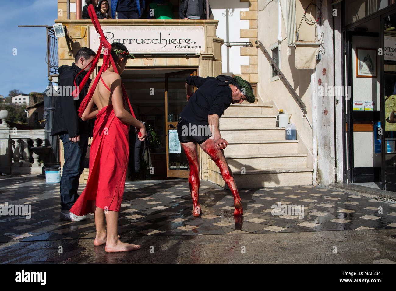 "Nocera Terinese, Italy, 31st March 2018. A ""Vattente"" performs his self inflicted torture on the town square. The ""Vattenti"" wear black shorts and only a black shirt as a sign of mourning for the crucifixion of Jesus Christ. Credit: Piero Castellano/Alamy Live News - Stock Image"