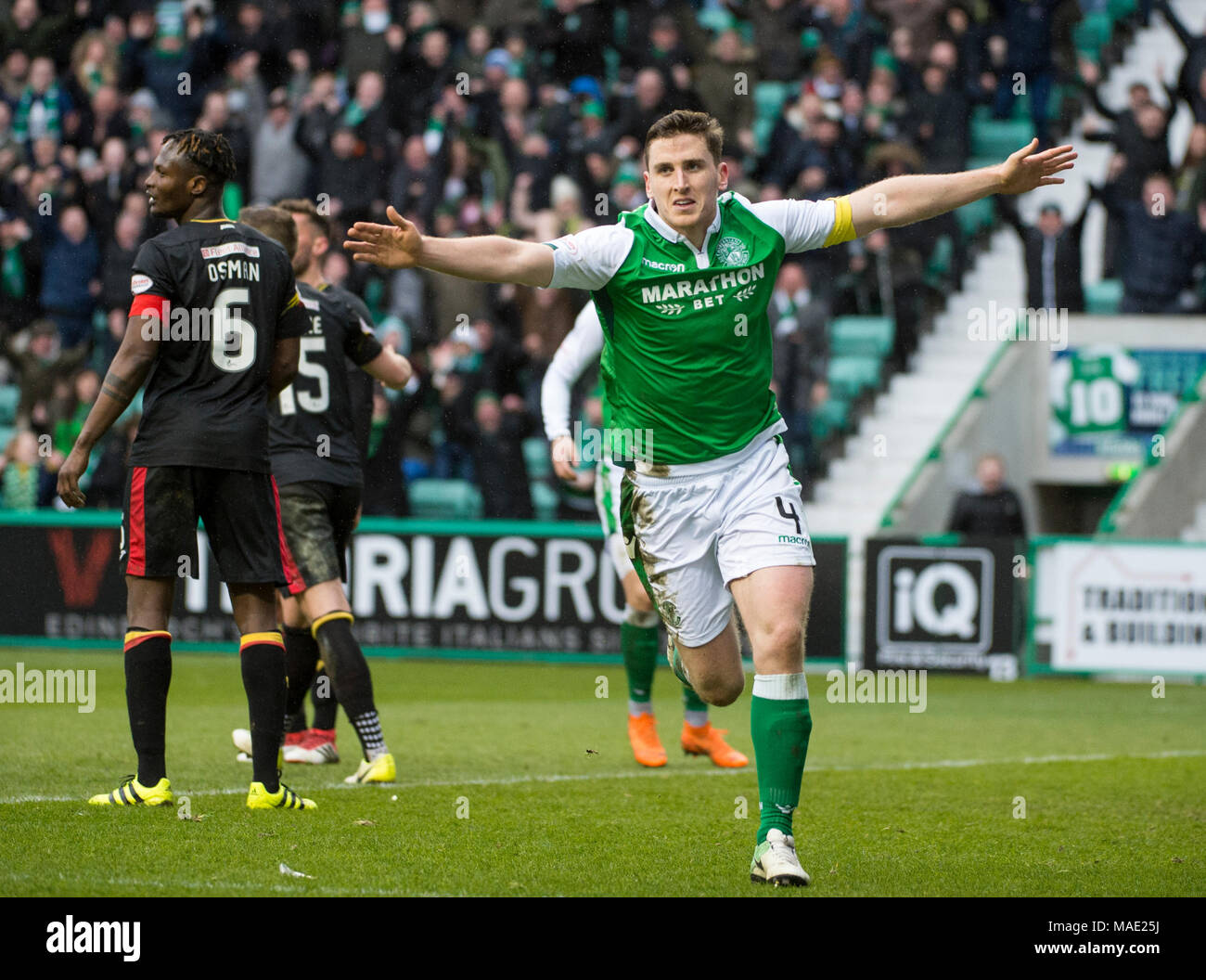 Edinburgh, UK, 31 Mar 2018.  Pic shows:  Hibs defender, Paul Hanlon, celebrates after scoring his side's second goal during the second half of the Scottish Premiereship clash between Hibernian and Partick Thistle at Easter Road Stadium, Edinburgh.  Credit: Alamy/Ian Jacobs - Stock Image