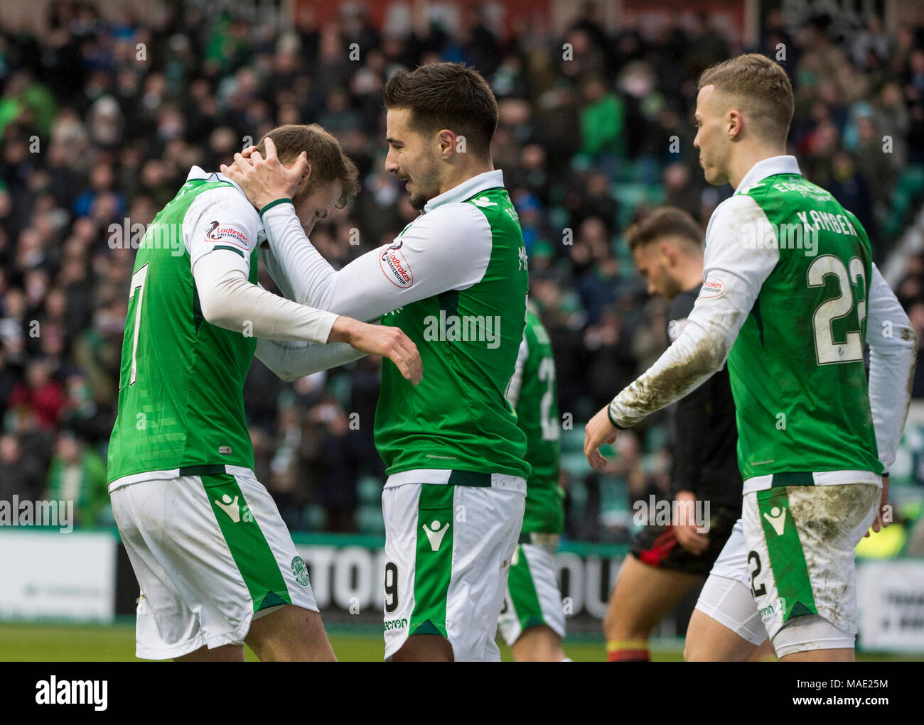 Edinburgh, UK, 31 Mar 2018.  Pic shows: Hibs celebrate after Jamie MacLaren scores the opening goal during the second half of the Scottish Premiereship clash between Hibernian and Partick Thistle at Easter Road Stadium, Edinburgh.  Credit: Alamy/Ian Jacobs - Stock Image