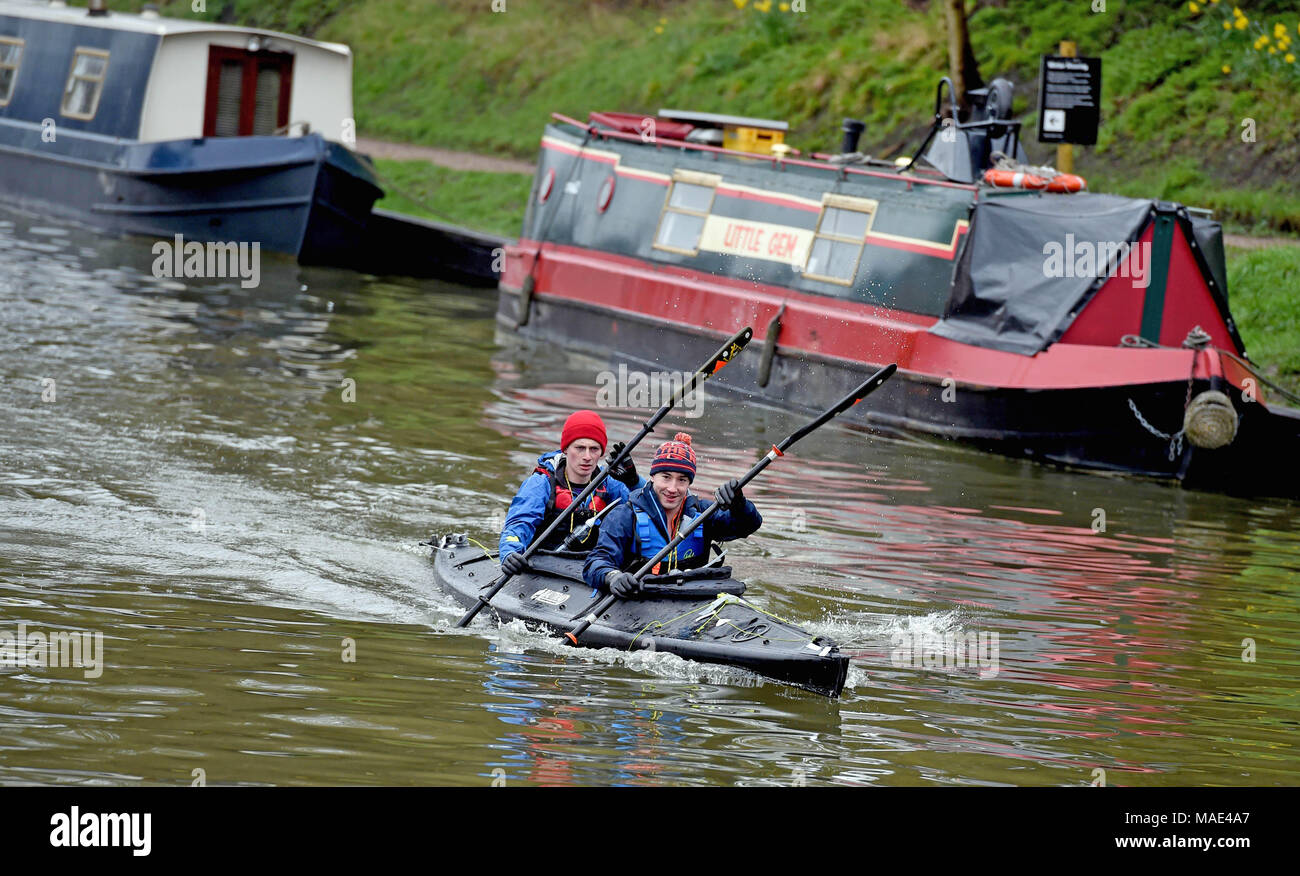 Devizes Wiltshire UK. 31st March 2018.  Tom Elliott and Robin Price take part in the 70th anniversary of the Devizes to Westminster canoe race over the Easter Weekend starting from Devizes wharf. Credit:  Diane Vose/Alamy Live News - Stock Image