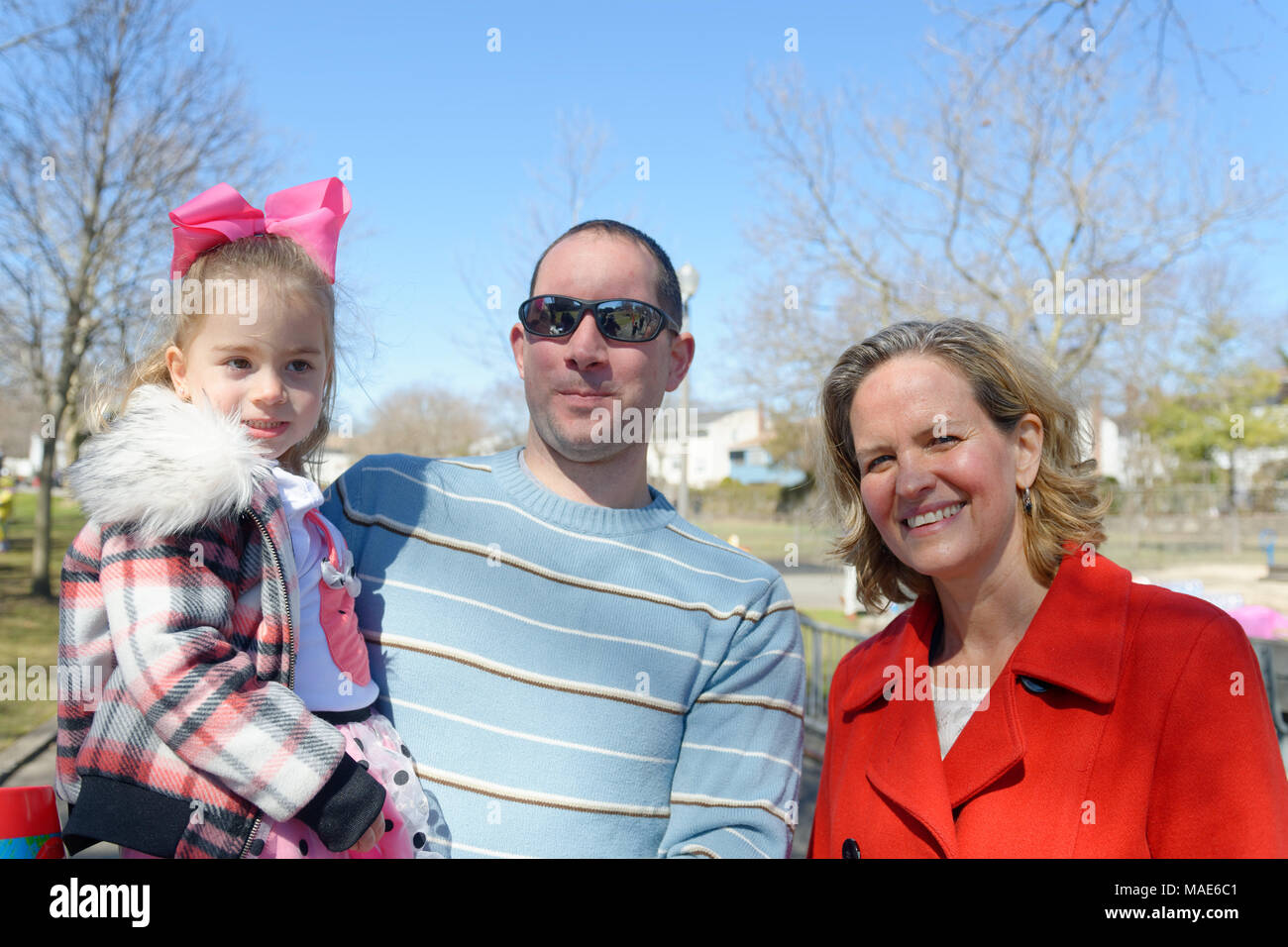 North Merrick, New York, USA. 31st Mar, 2018. R-L, Nassau County Executive LAURA CURRAN poses with ROBERT SCHMID and his daughter BRIDGET SCHMID, 2, of Merrick, at the Annual Eggstravaganza, held at Fraser Park and hosted by North and Central Merrick Civic Association (NCMCA) and Merrick's American Legion Auxiliary Unit 1282. Credit: Ann Parry/ZUMA Wire/Alamy Live News - Stock Image