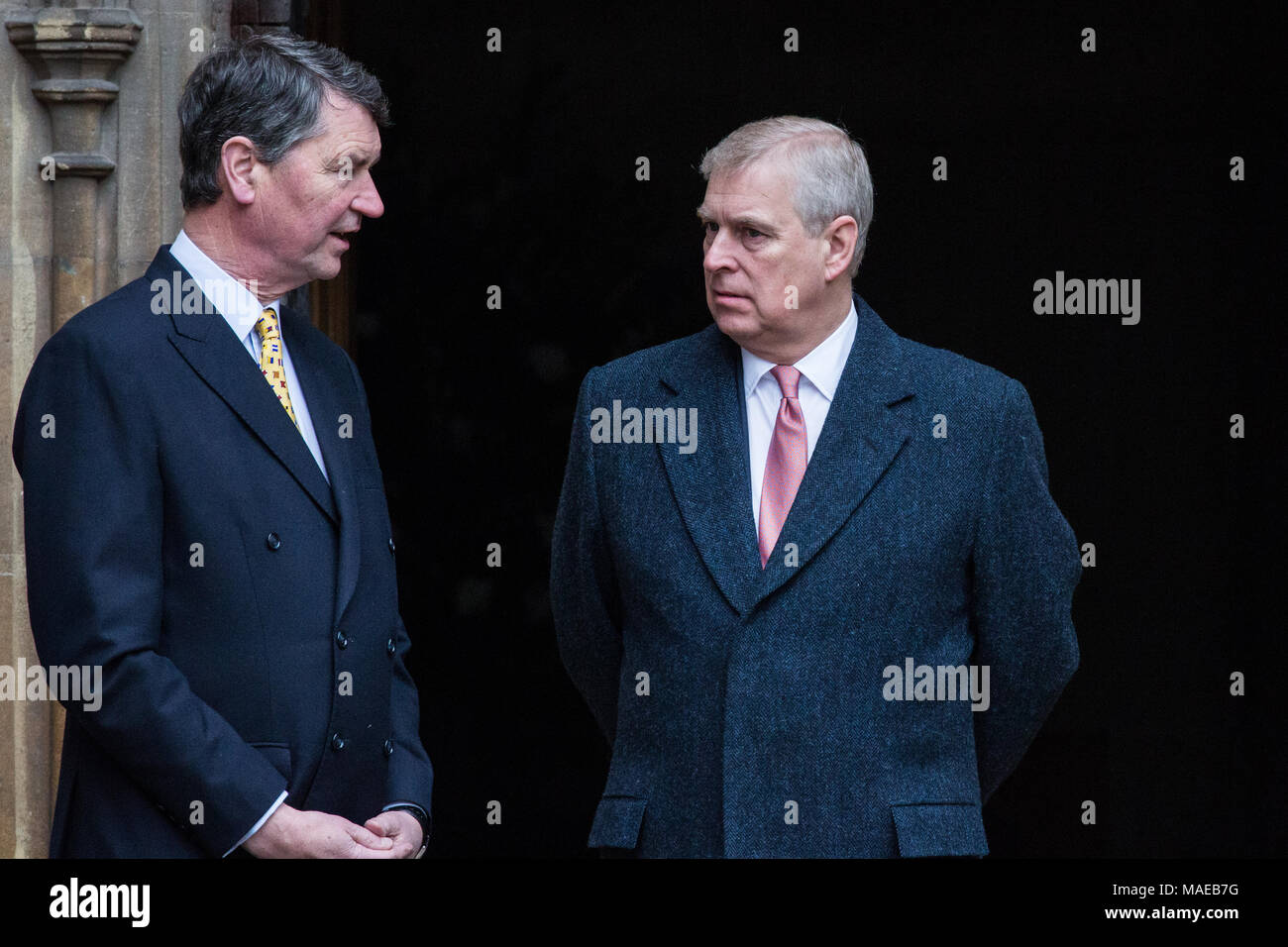 Windsor, UK. 1sat April, 2018. Prince Andrew, the Duke of York, speaks to Vice Admiral Sir Timothy Laurence outside St George's Chapel in Windsor Castle before the Easter Sunday service. - Stock Image