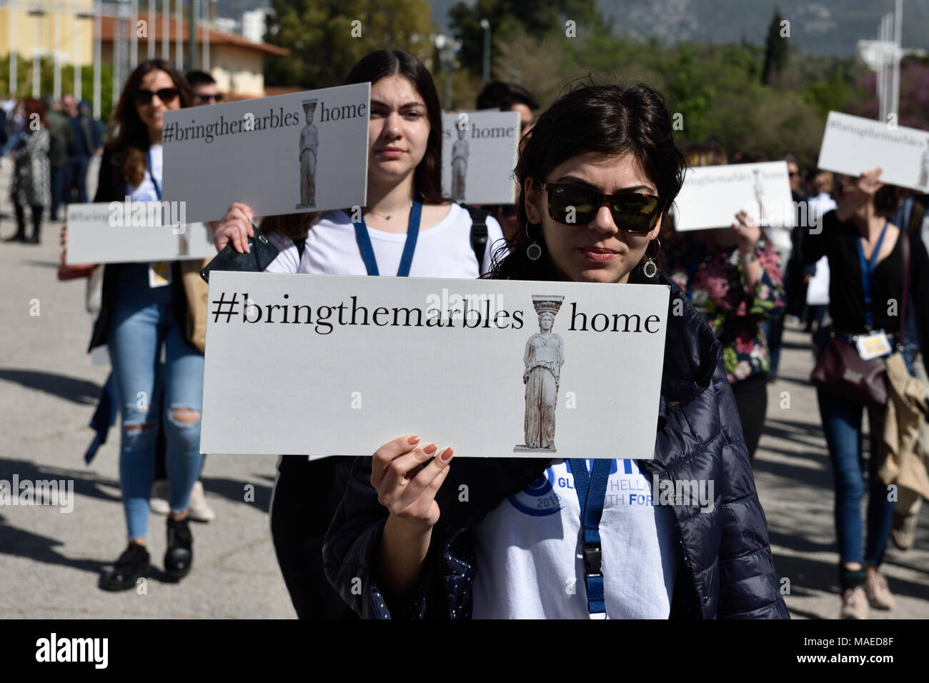 Athens, Greece, 1st April, 2018. Members of the Hellenic Youth in Action, a Greek diaspora youth forum, march holding placards demanding the return of the Parthenon marbles in Athens, Greece. Credit: Nicolas Koutsokostas/Alamy Live News. - Stock Image