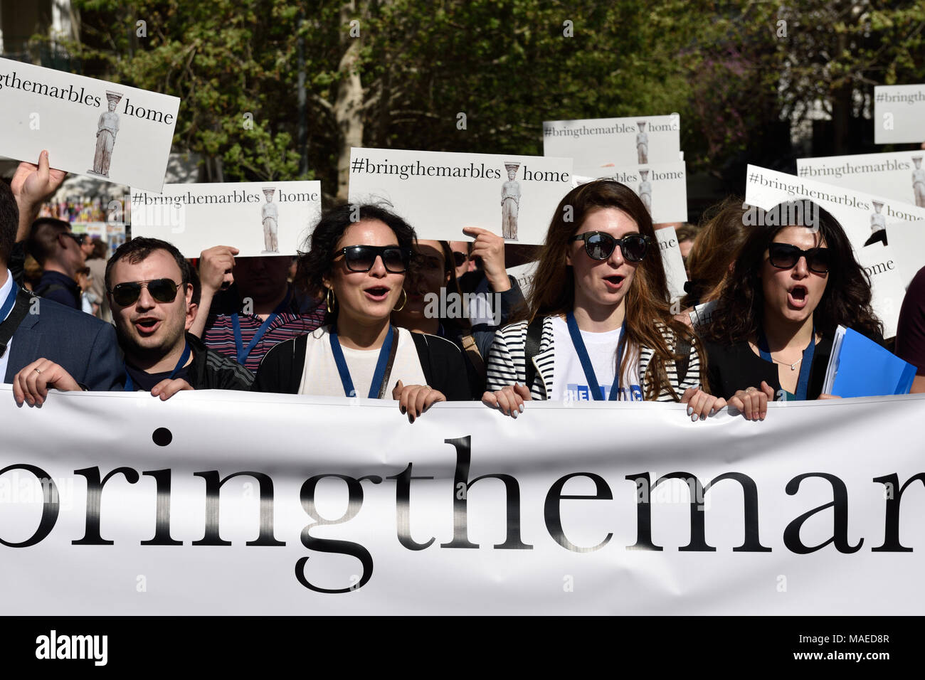 Athens, Greece, 1st April, 2018. Members of the Hellenic Youth in Action, a Greek diaspora youth forum, march holding banners and placards demanding the return of the Parthenon marbles in Athens, Greece. Credit: Nicolas Koutsokostas/Alamy Live News. - Stock Image