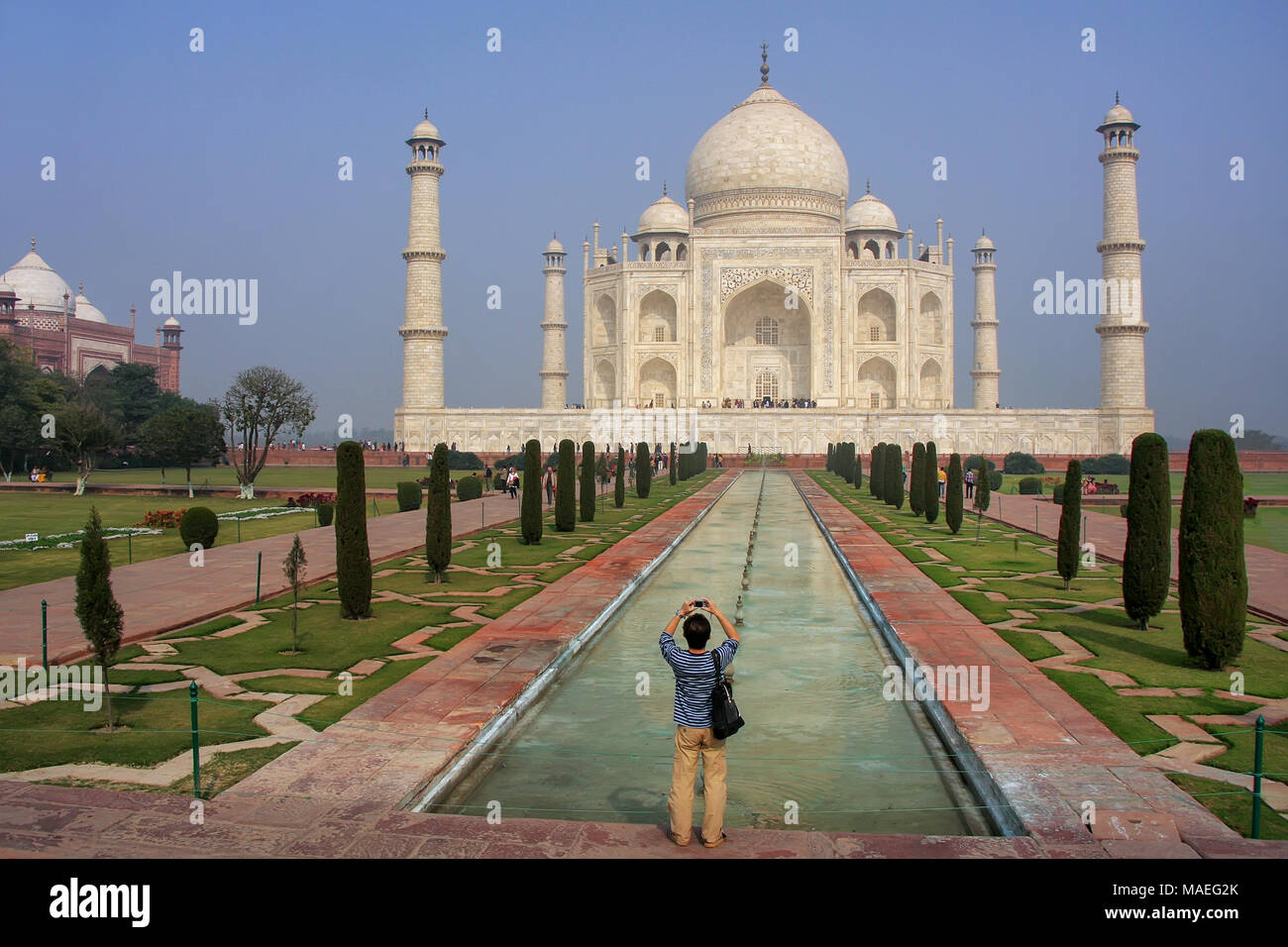 Tourist photographing Taj Mahal in Agra, Uttar Pradesh, India. It was build in 1632 by Emperor Shah Jahan as a memorial for his second wife Mumtaz Mah - Stock Image