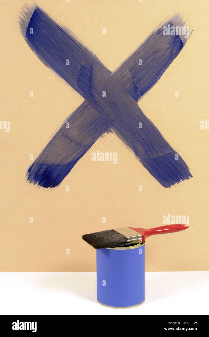Blue cross or letter X painted on a wood wall with paint can and ...