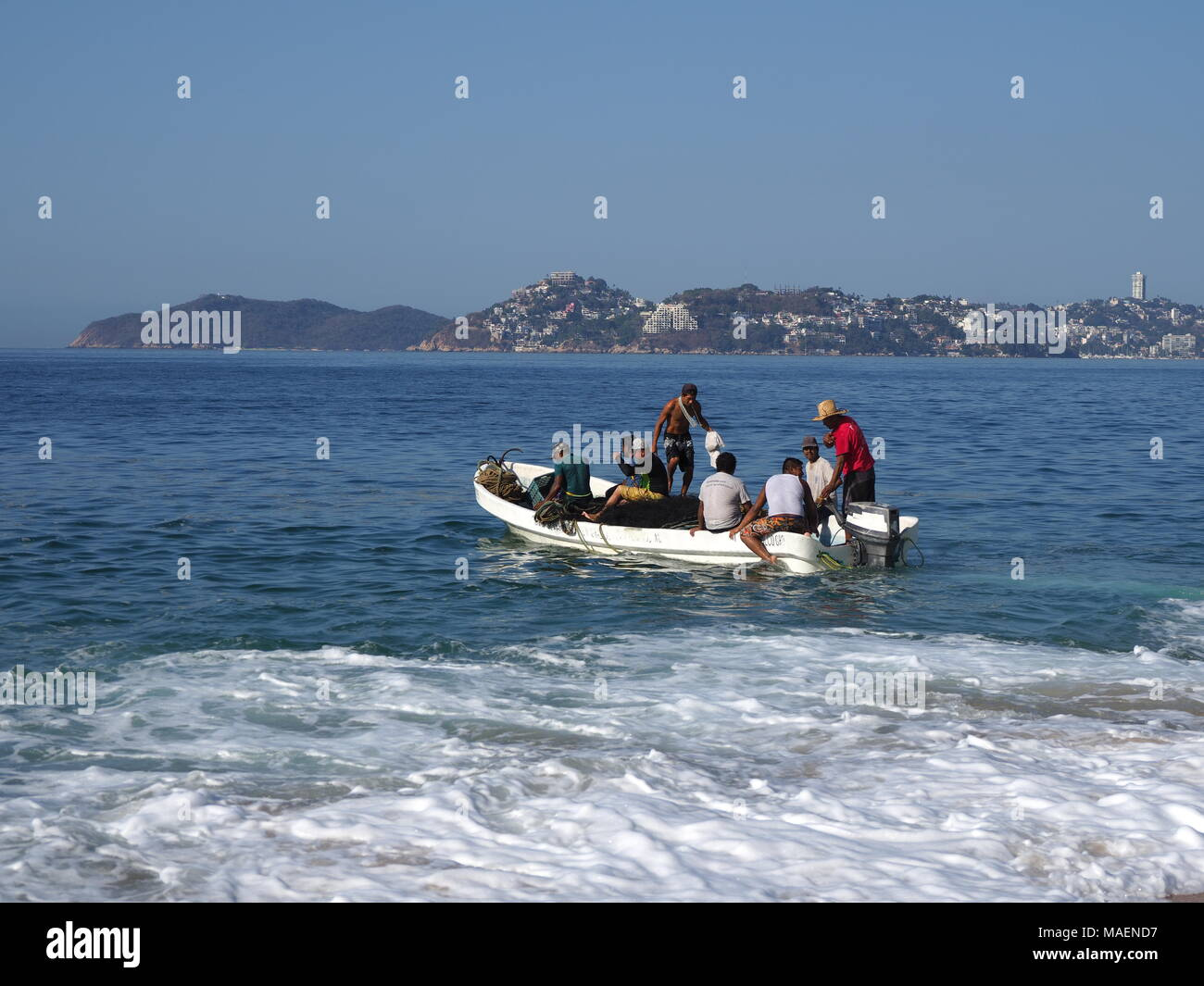 ACAPULCO, MEXICO NORTH AMERICA on MARCH 2018: Motor boat for fishing, tourist excursions of Pacific Ocean waves in mexican city, scenic landscapes of  Stock Photo
