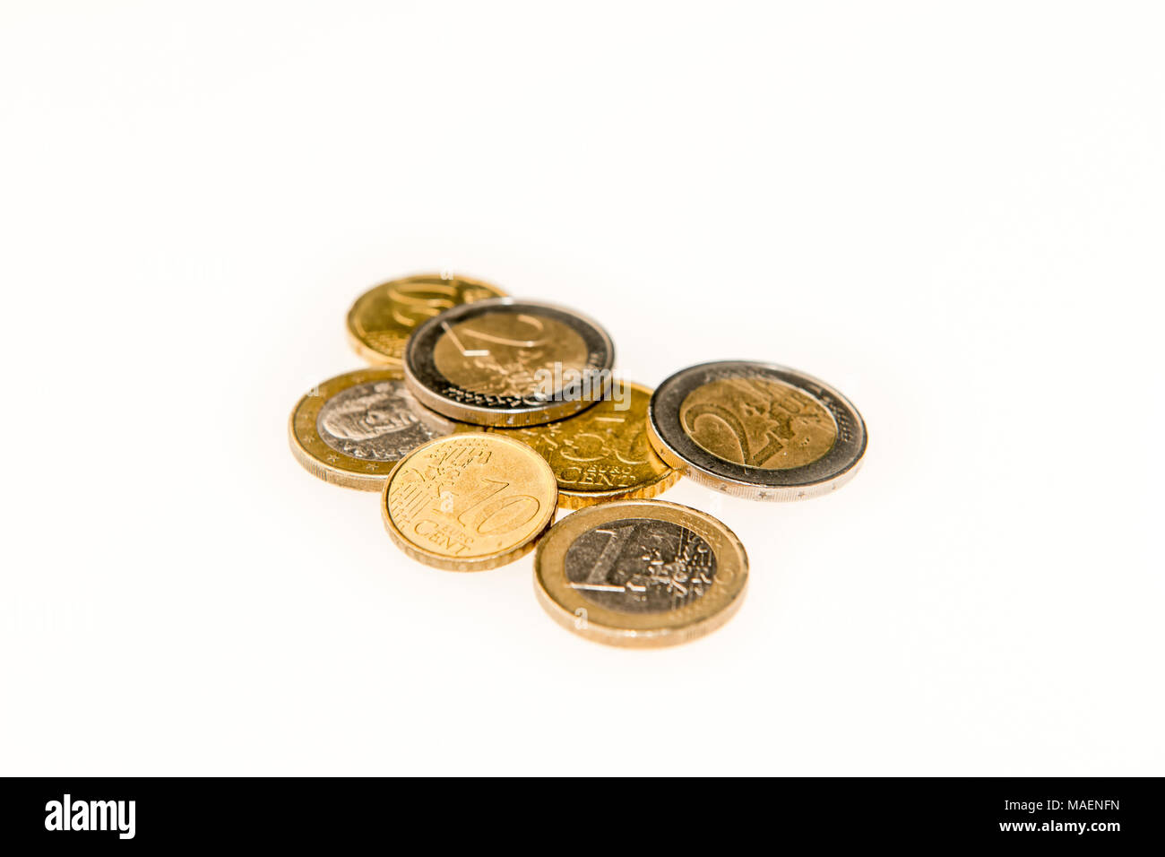 Various kinds of Euro coins on a white background - Stock Image