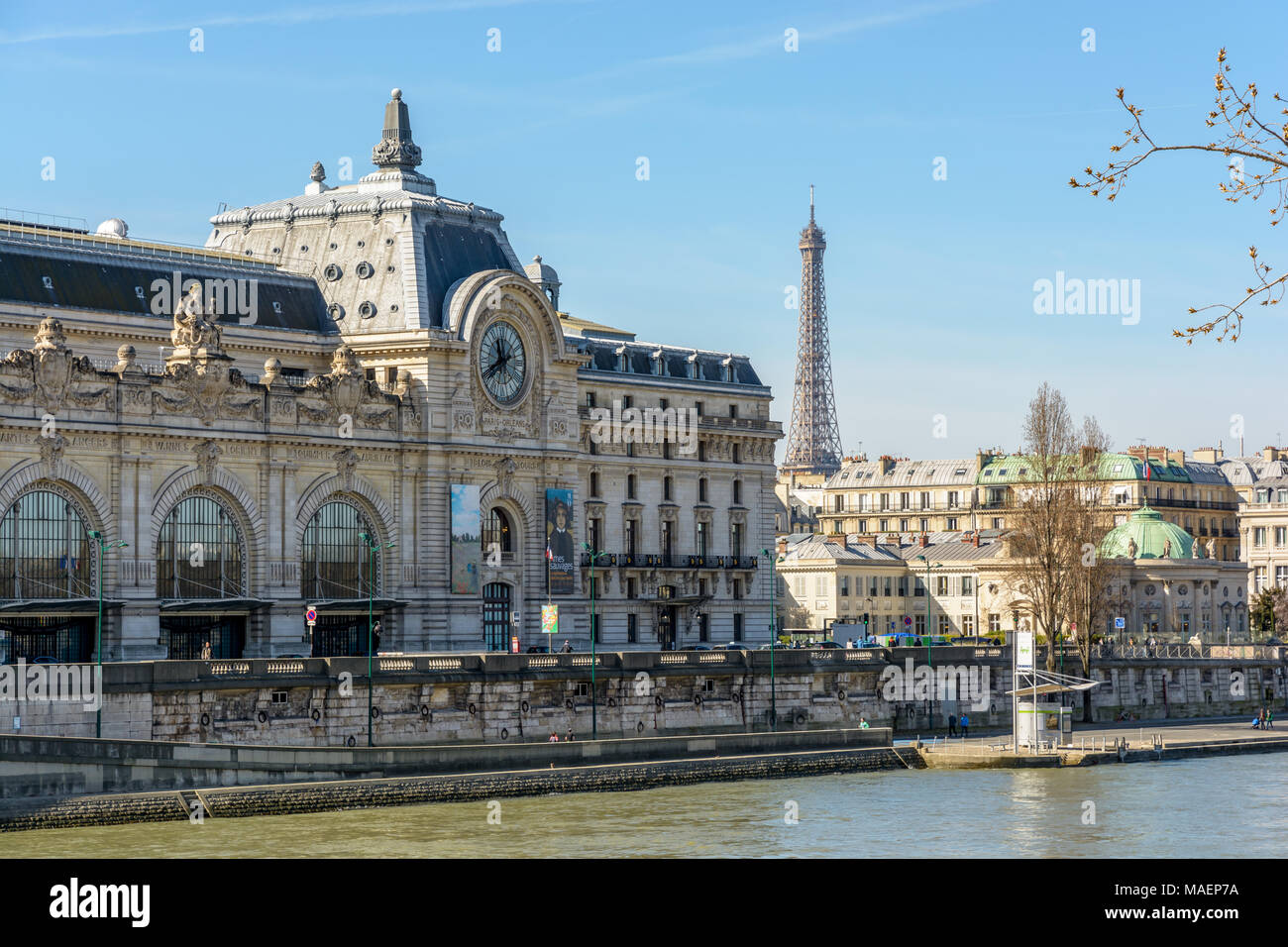 Paris, France - March 14, 2018: View of the facade of the former Orsay train station which houses the Orsay museum since 1986, with the Eiffel tower i Stock Photo