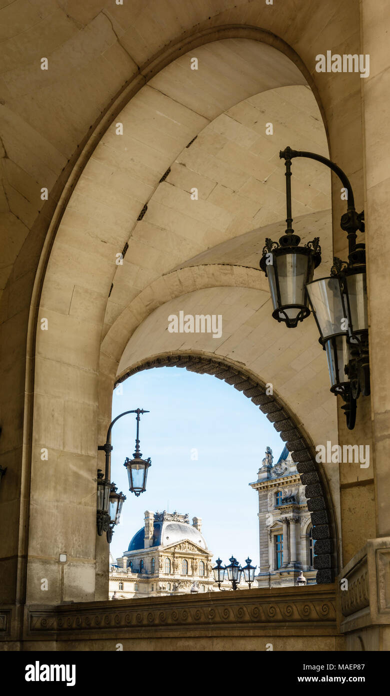 Paris, France - March 14, 2018: View of the Richelieu pavilion of the Louvre palace in Paris from the arches of the Guichets Lesdiguieres with vintage Stock Photo
