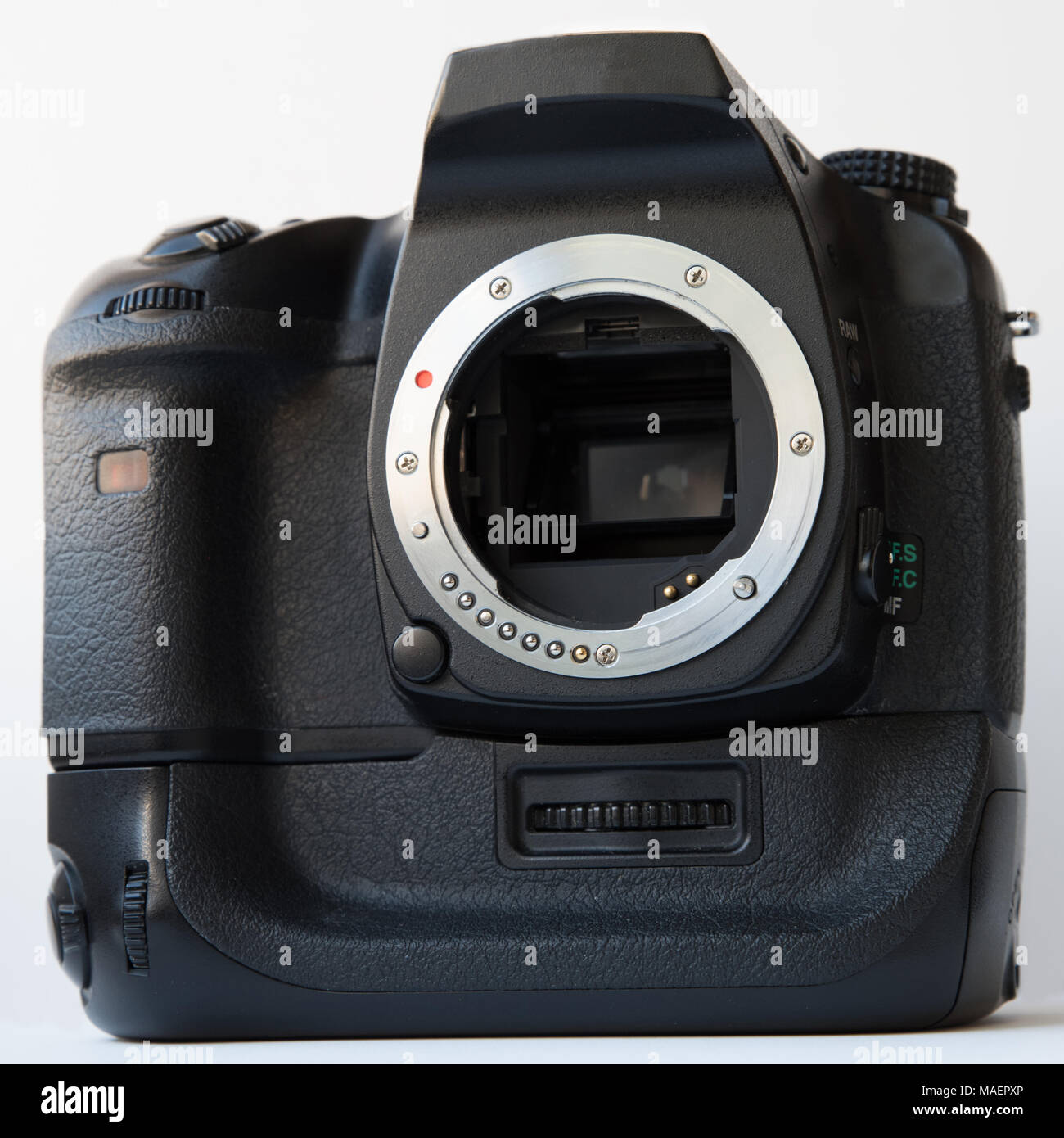 Digital SLR camera with vertical battery grip over white background - Stock Image