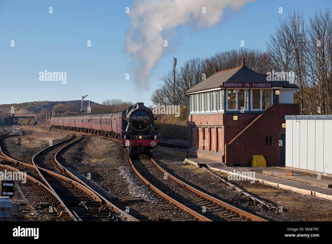LMS Steam locomotive 45690 Leander with a Carlisle - Euston 'Cumbrian Coast Express' operated by West Coast Railways  at Barrow In Furness - Stock Image