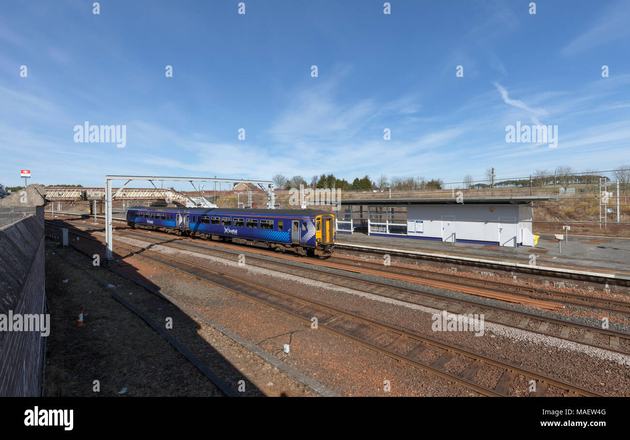 A Scotrail class 156 sprinter train calling at  Carstairs junction station, Scotland on the west coast main line - Stock Image