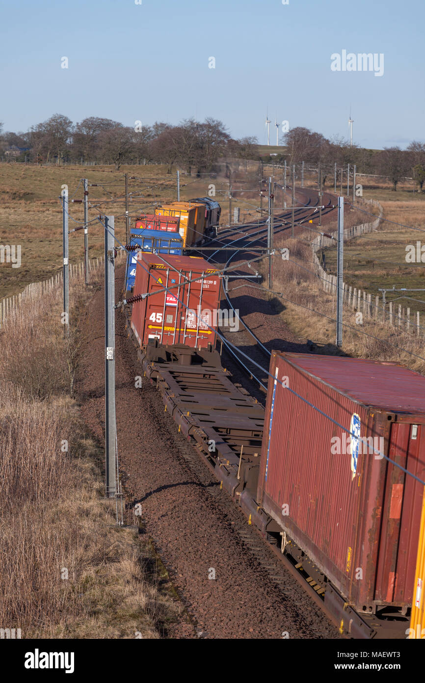 DB Cargo intermodal container freight  train passing Auchengray (between Carstairs and Edinburgh) on the west coast main line - Stock Image