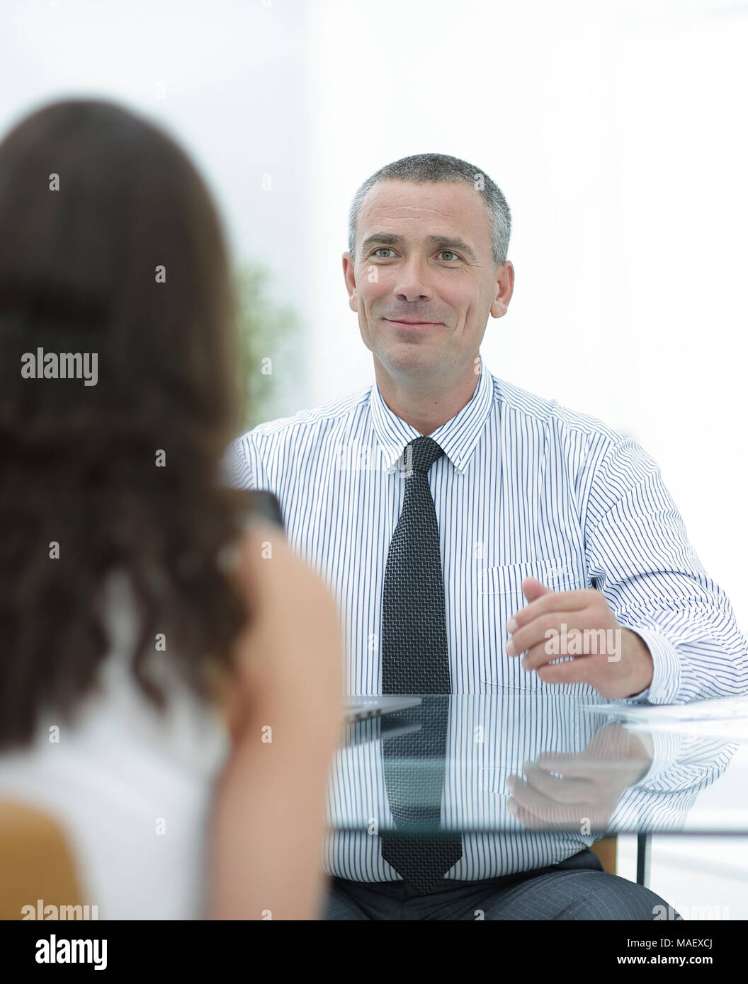 business consultant sits at his Desk and consult with their client - Stock Image