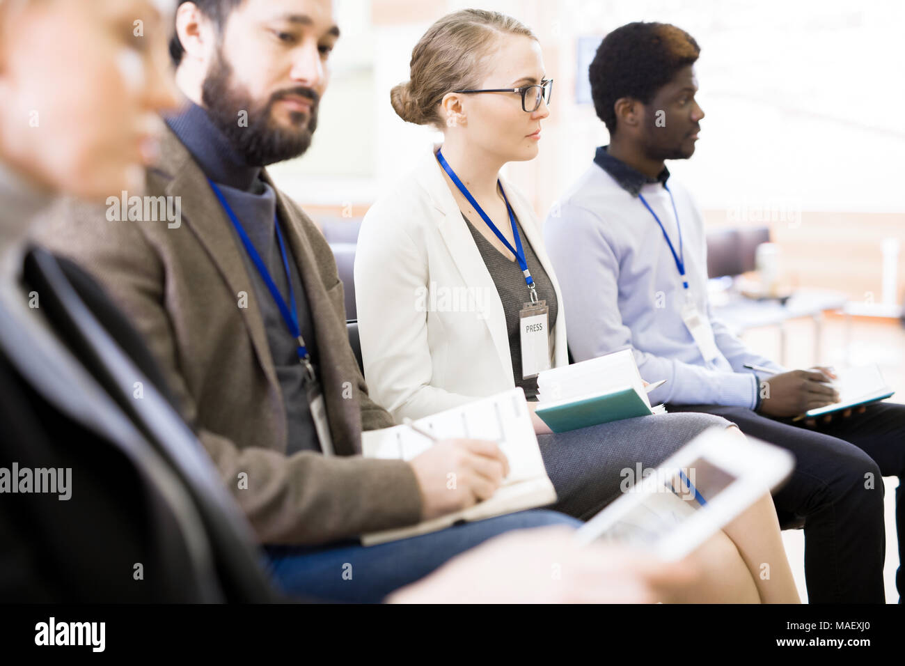 Highly Professional Journalists at Press Conference - Stock Image