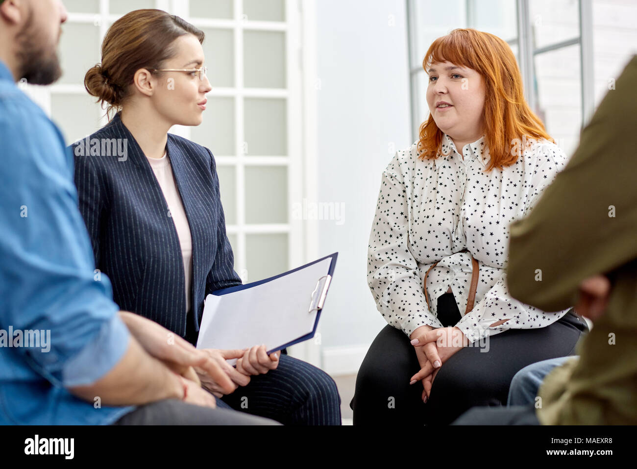Conducting Group Therapy Session - Stock Image